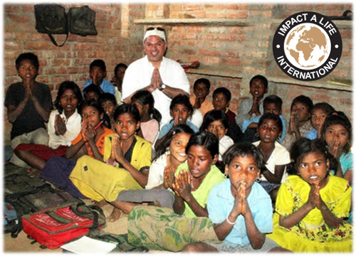 Cyrus Mafi with the children of Nepal with Impact-A-Life